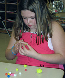 Student examining cubes